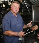 Photo of Coach Ditka grilling the best Steak he ever had